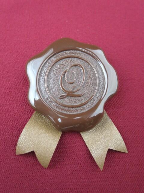 Q-pot. シーリングチョコレート ブローチ